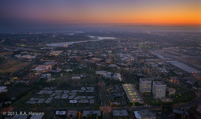 Includes Irvine and Newport Beach cityscape in foreground