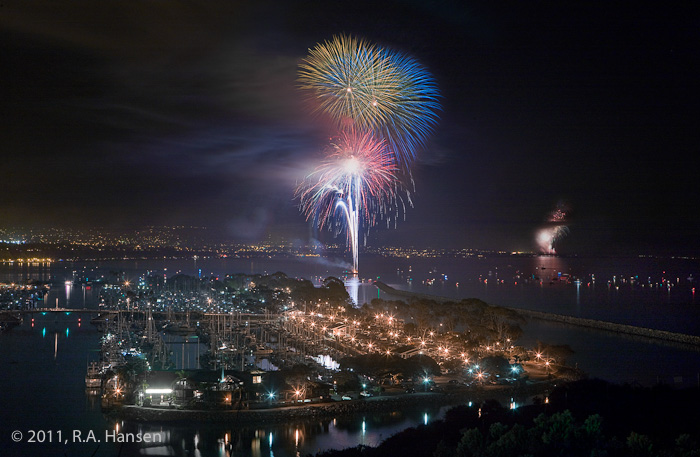 On July 4th, 2011, these bursts over Dana Point and San Clemente in the background add excitement to the illuminated boats in...