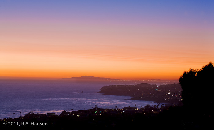 This expansive view on a clear evening shows the coastline all the way to the distant Palos Verdes peninsula, which is silhouetted...
