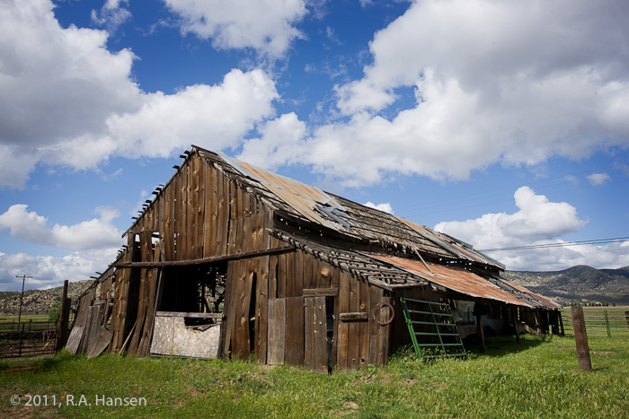 This decrepit shell stands in stark contrast to the blue sky and clouds above
