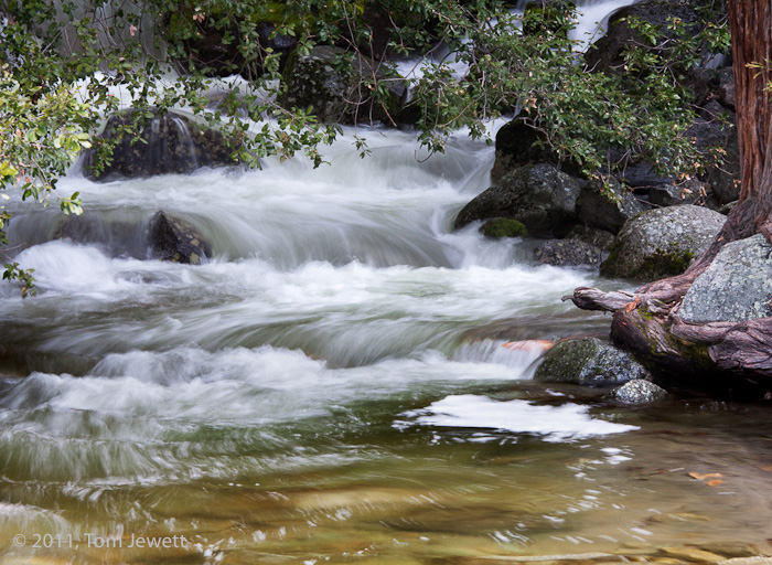 Cascade Fall empties into the Merced River just outside the park entrance along Highway 41. Photo by Tom Jewett.