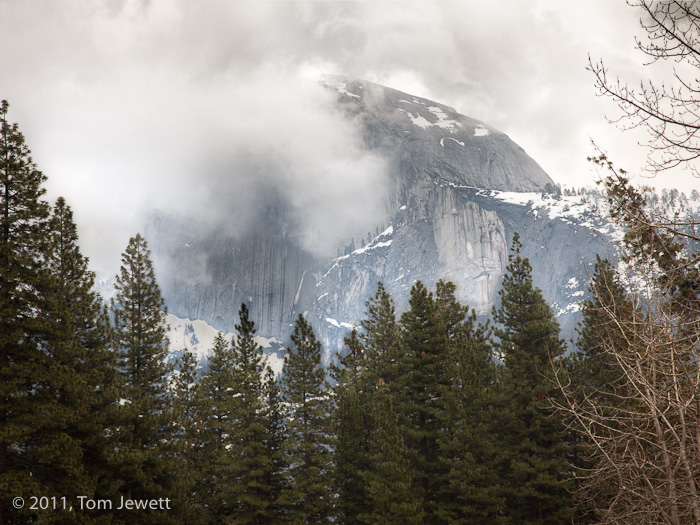 Unlike most views of this iconic Yosemite landmark, a winter afternoon shows it half-hidden by low clouds. Photo by Tom Jewett...