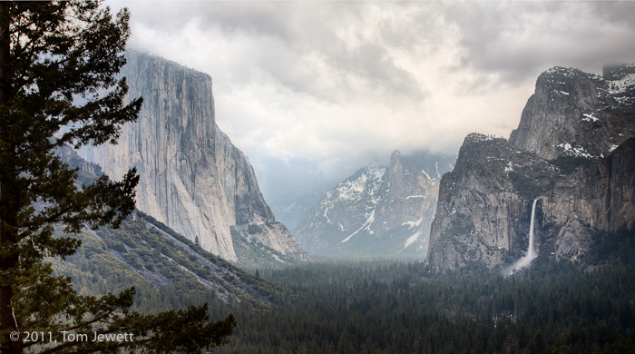 Winter low clouds hang over the valley in this image from the Tunnel View overlook, obscuring background features like Half Dome...
