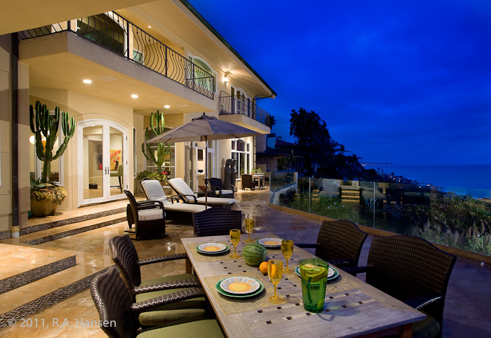 Patio dining at an elegant residence with ocean view. For more residential and commercial architecture images, please visit Robert...