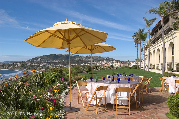 Ocean-view patio tables and yellow umbrellas await guests at this exclusive resort. For more residential and commercial architecture...