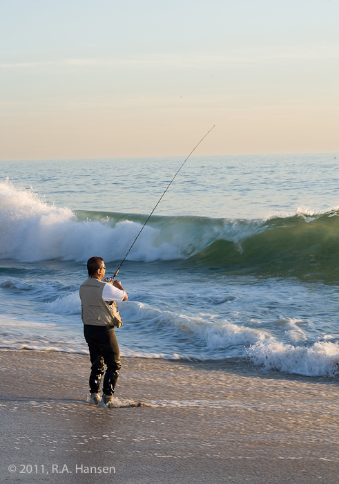A guest tries his luck at surf-fishing along the coast at this luxury resort