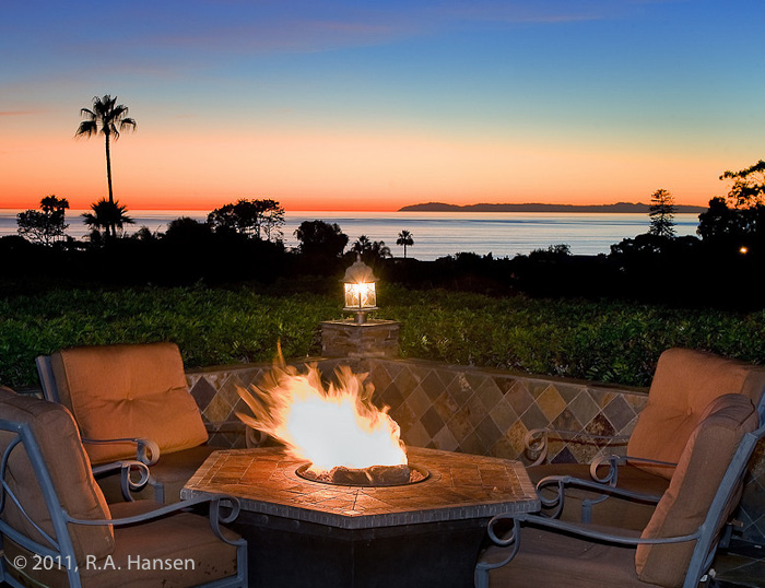 Evening by the fire pit an an elegant residence. For more residential and commercial architecture images, please visit Robert...