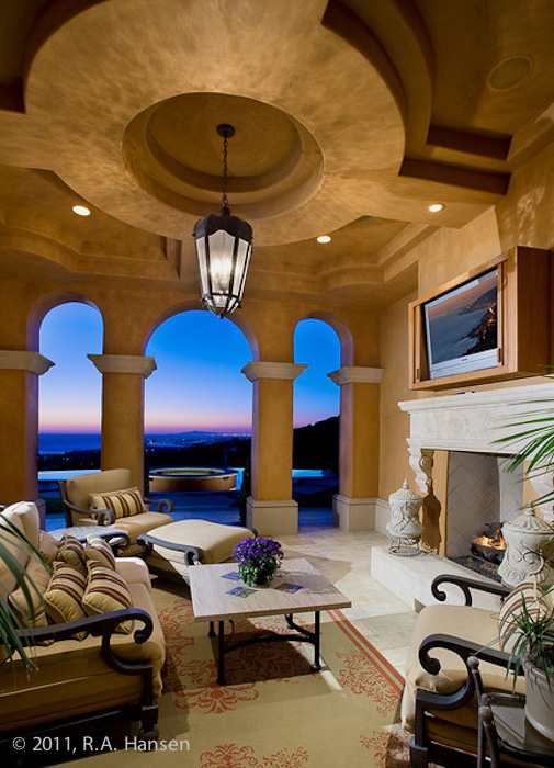 Owners enjoy an ocean view of the sunset from this elegant residence. For more residential and commercial architecture images...