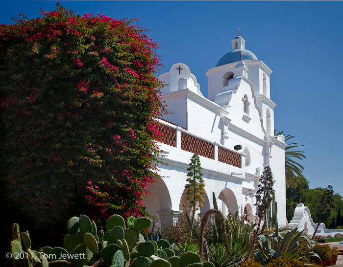 Garden and façade, view #2 -- This mission is not only an active parish church, it is a major educational and retreat...