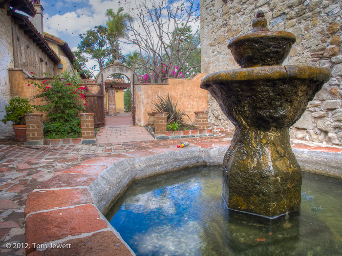 Fountain and courtyard.  This intimate area is located behind the main church bells, between the ruins of the Great Stone Church...
