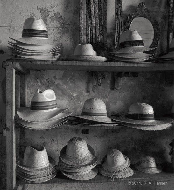 I came upon this display of handmade hats and belts in Merida, Yucatan one morning and made this photograph. Needless to say...